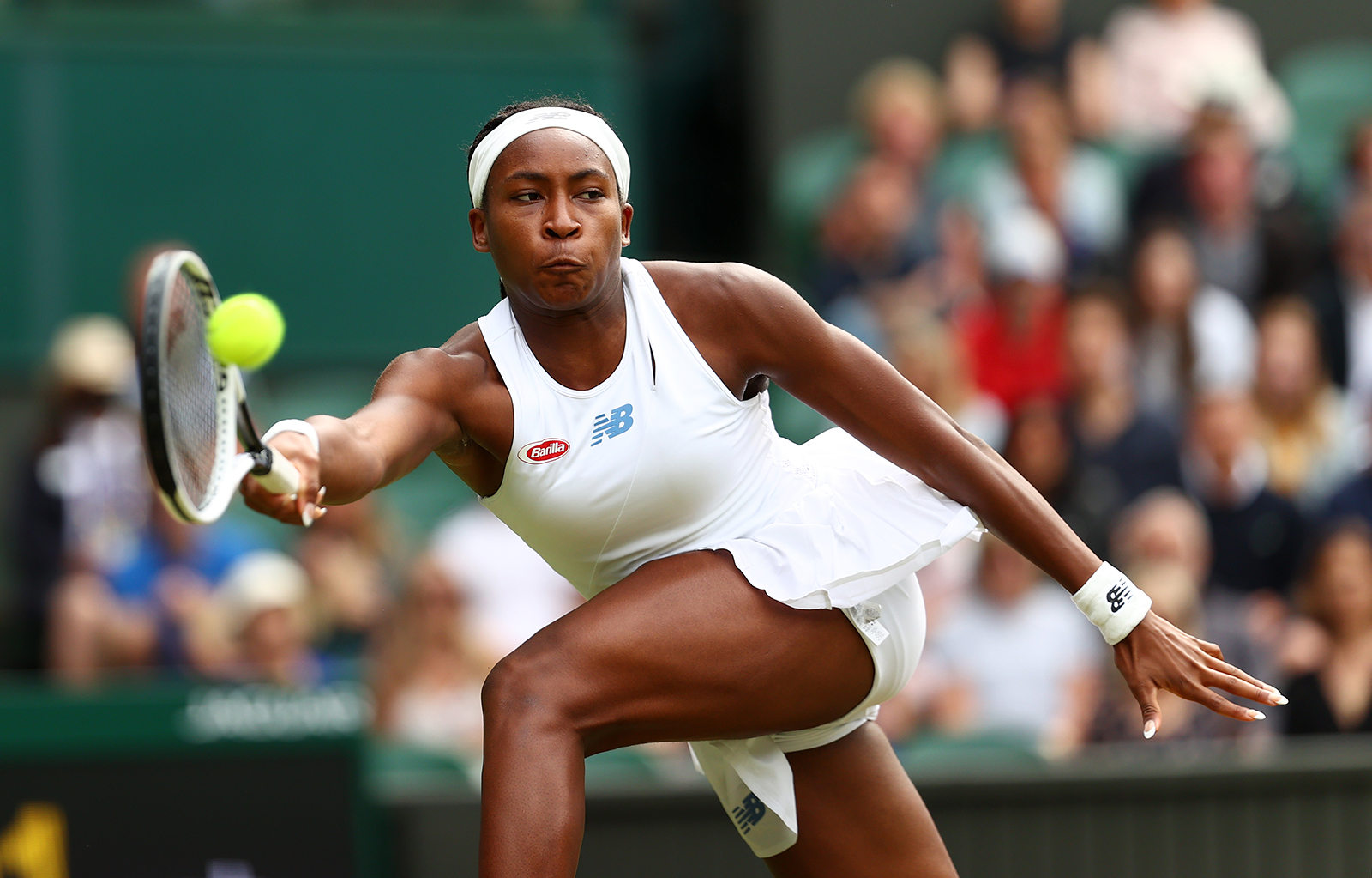 Coco Gauff competes in a match against Angelique Kerber of Germany during Wimbledon on July 5 in London, England. Gauff will miss the Tokyo Olympics after announcing on Twitter July 18 she tested positive for Covid-19.