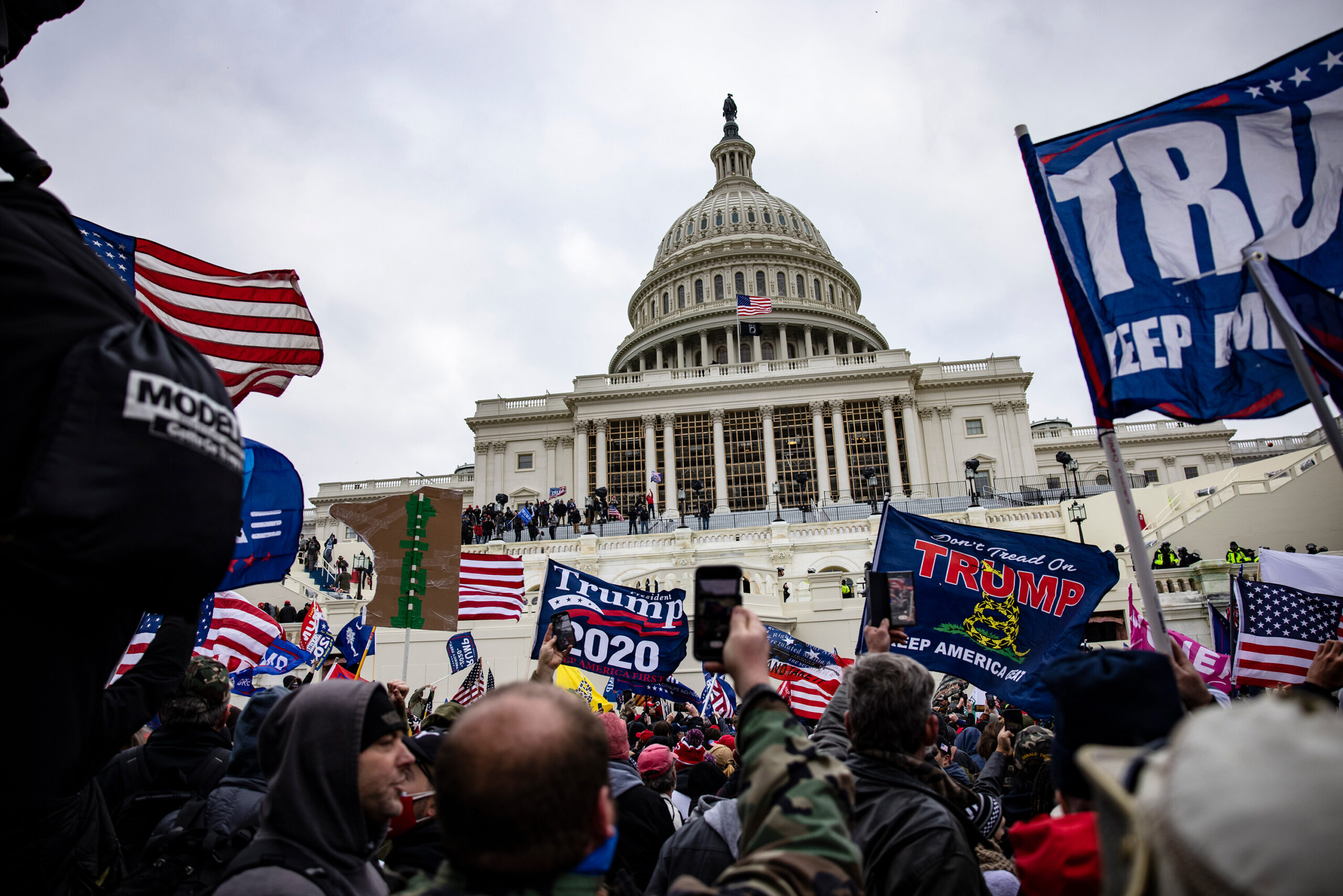 <i>Samuel Corum/Getty Images</i><br/>Pro-Trump supporters storm the U.S. Capitol following a rally with President Donald Trump on January 6. The Justice Department formally declined to assert executive privilege for potential testimony of at least some witnesses related to the January 6 Capitol attack.