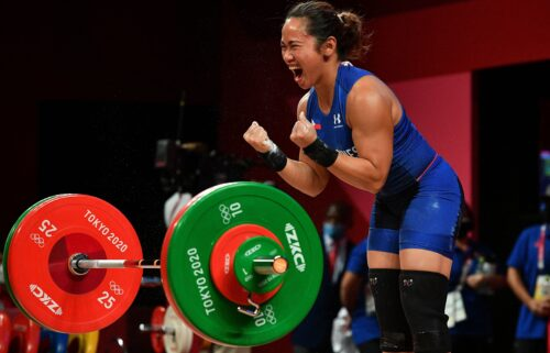 Philippines' Hidilyn Diaz reacts while competing in the women's 55kg weightlifting competition during the Tokyo 2020 Olympic Games.