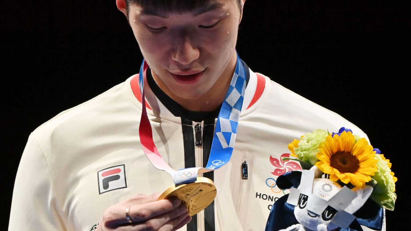 <i>Fabrice Coffrini/AFP/Getty Images</i><br/>Fencing gold medallist Cheung Ka Long of Hong Kong looks at his medal while on the podium during the medal ceremony for the Men's Individual Foil during the Tokyo 2020 Olympic Games at the Makuhari Messe Hall in Chiba City
