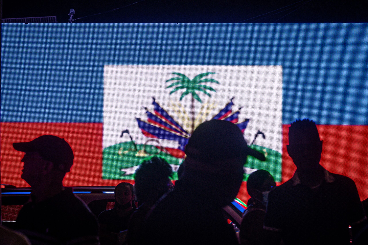 <i>GIORGIO VIERA/AFP/AFP via Getty Images</i><br/>People attend a vigil in honor of Haiti's slain president Jovenel Moise