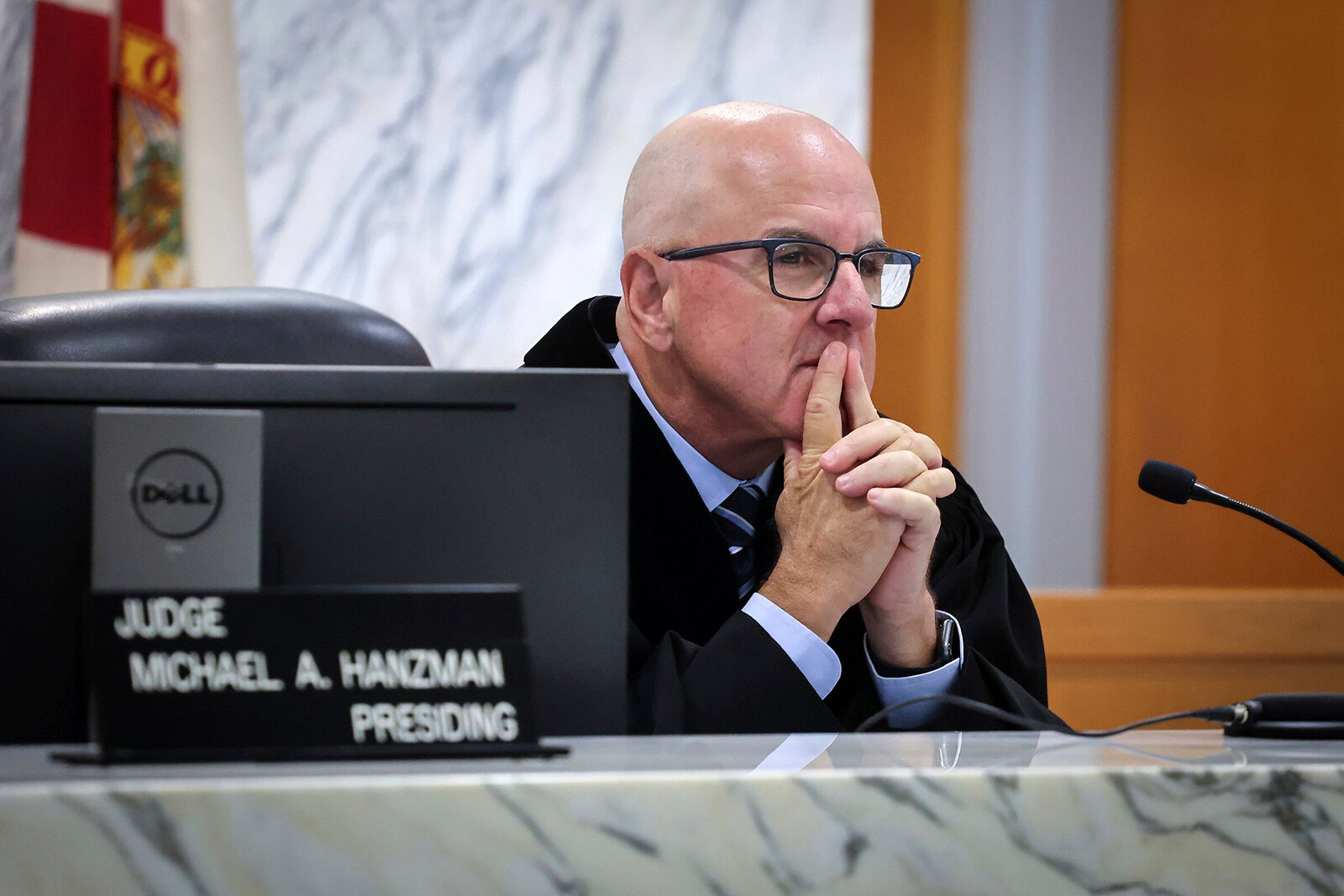 <i>Carl Juste/AP</i><br/>Miami-Dade Circuit Judge Michael Hanzman listens as tenants share their thoughts regarding the future of the site of the Champlain Towers South building that collapsed in Surfside.