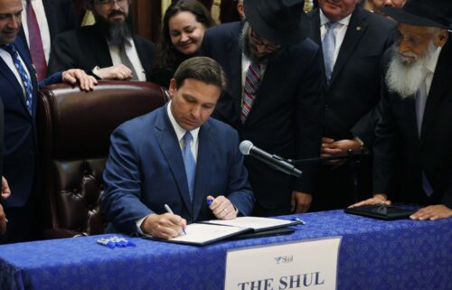 """Florida Gov. Ron DeSantis' warning this week of a """"Faucian distopia"""" offered the latest glimpse at how ambitious Republicans eyeing 2024 presidential bids are increasingly targeting public health officials as they attempt to grow their national brands in front of conservative audiences. DeSantis is shown here signing two bills at the Shul of Bal Harbour on June 14"""