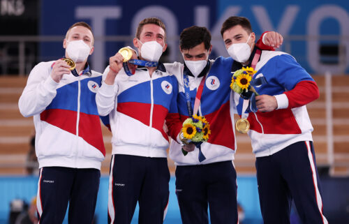 Gymnasts from Team ROC pose with the gold medal after winning the Men's Team Final on day three of the Tokyo Olympic Games.