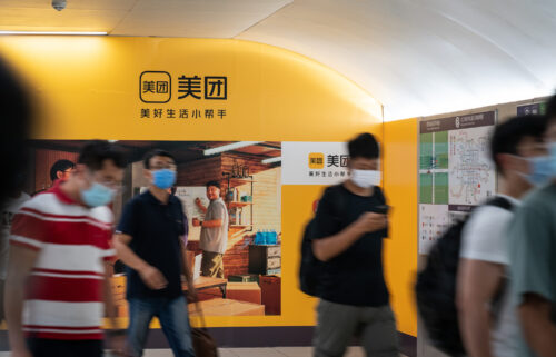 A Meituan ad inside a subway station is pictured in Beijing in July. Chinese tech stocks keep getting slammed with a massive sell-off that has wiped out hundreds of billions of dollars in market value as investors continue to digest Beijing's widening crackdown on private enterprise.