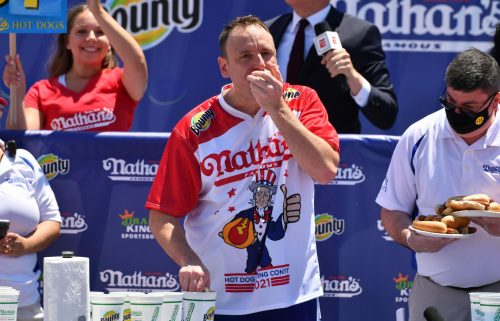 Joey Chestnut beat his own world record to win the hot dog eating contest for a 14th time in 15 years.