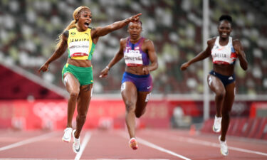 Elaine Thompson-Herah celebrates as she wins 100m gold at the Tokyo Olympics.