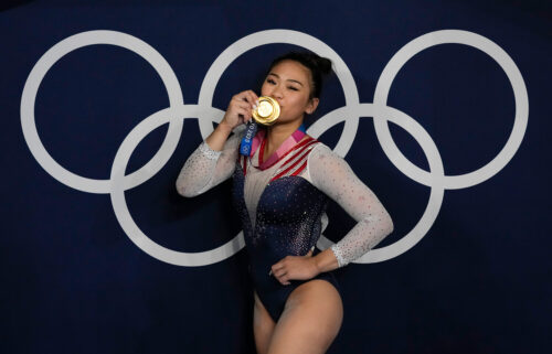 Suni Lee reacts as she poses for a picture after winning the gold medal in the artistic gymnastics women's all-around final on July 29 in Tokyo