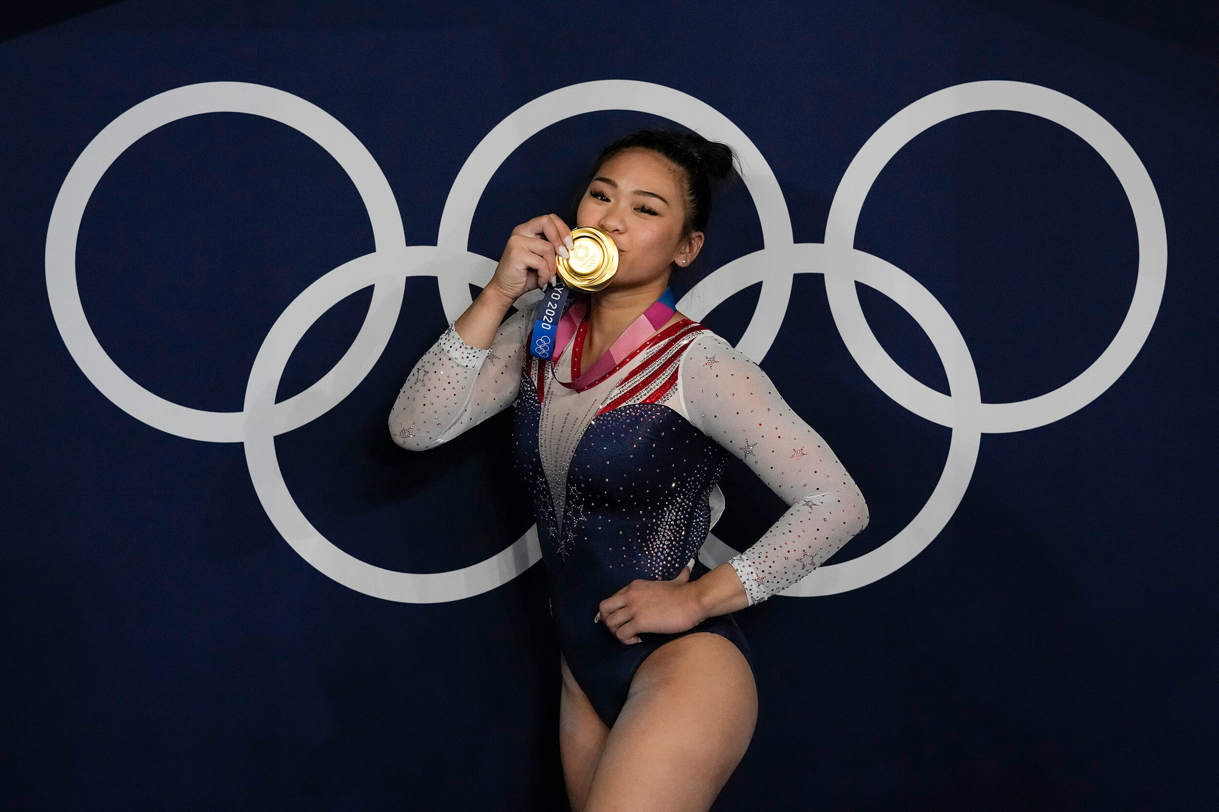 <i>Gregory Bull/AP</i><br/>Suni Lee reacts as she poses for a picture after winning the gold medal in the artistic gymnastics women's all-around final on July 29 in Tokyo
