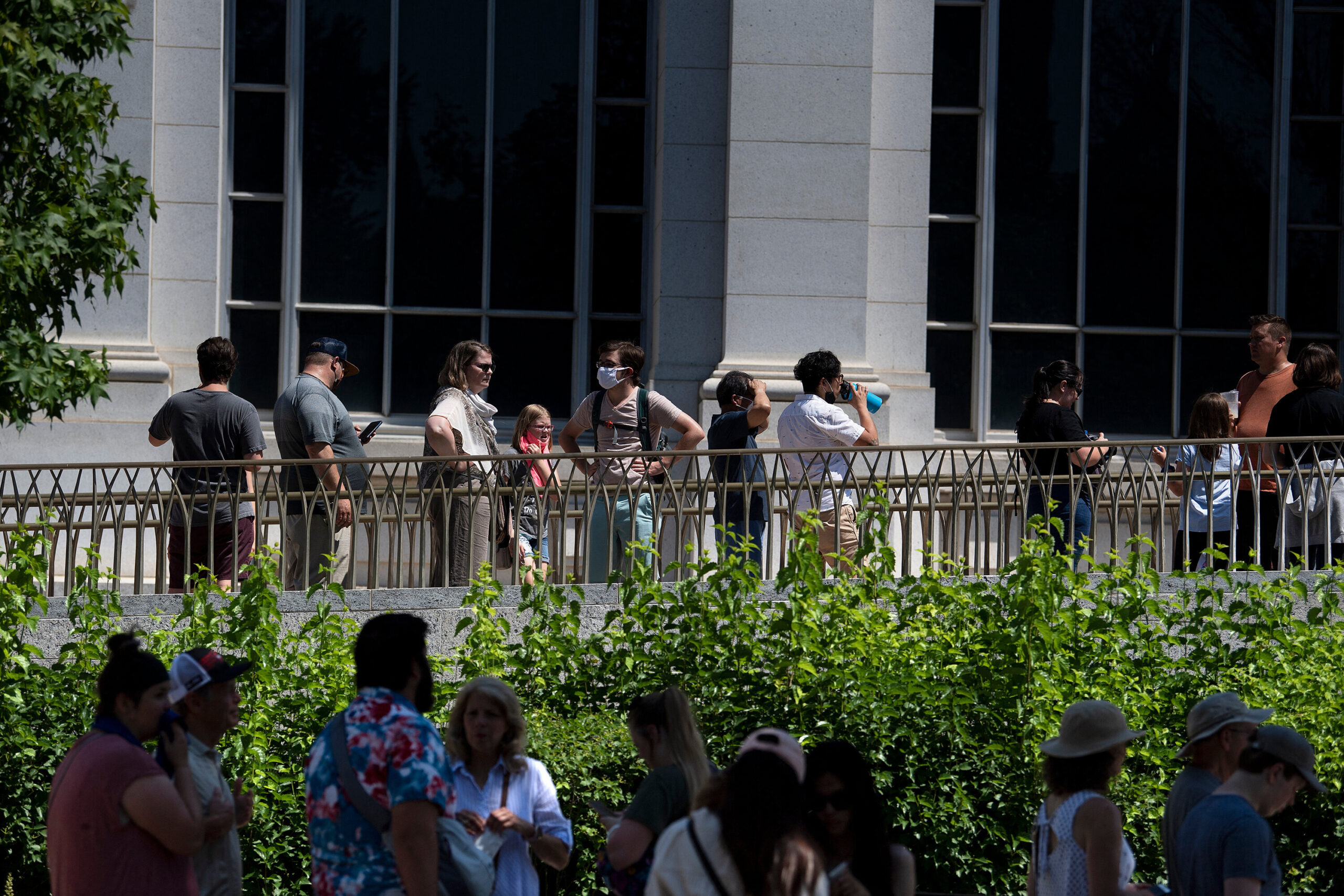 <i>Brendan Smialowski/AFP/Getty Images</i><br/>People wait in line to enter the Smithsonian's Natural History Museum as the DC area experiences a heatwave on June 30
