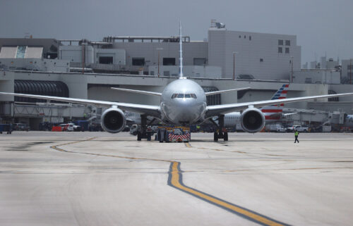 An American Airlines plane is prepared for takeoff at the Miami International Airport on June 16 in Miami