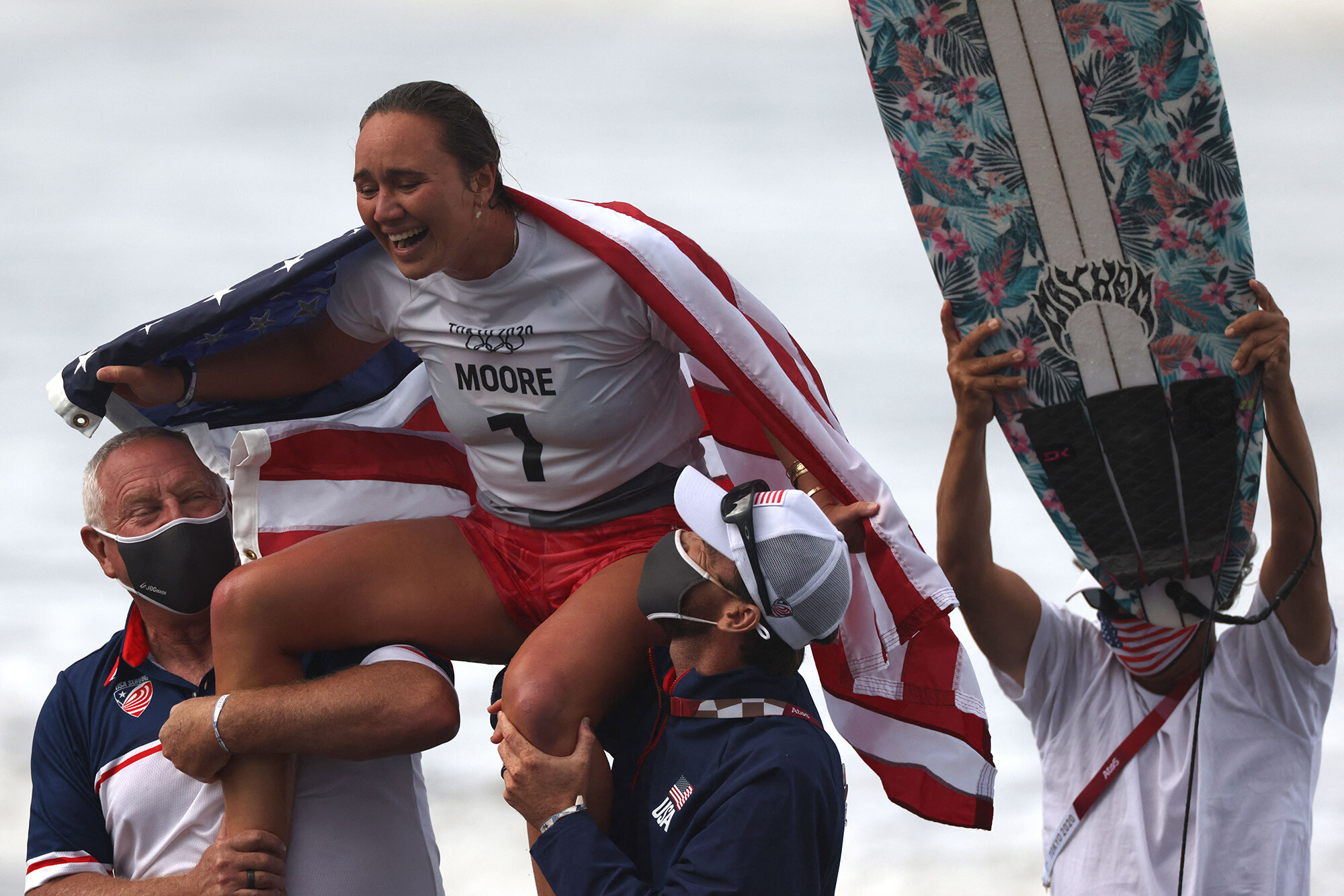 <i>Yuki Iwamura/AFP/Getty Images</i><br/>US's Carissa Moore celebrates after winning the women's Surfing gold medal final at the Tsurigasaki Surfing Beach