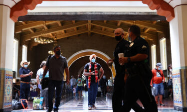 People wear face coverings at Union Station in Los Angeles on July 19. Despite now having a powerful tool to help suppress the spread of coronavirus -- three very effective vaccines -- the nation is once again seeing rising cases