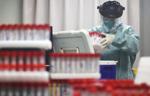 A medical worker works on samples from local residents to be tested for Covid-19 at a laboratory in Nanjing