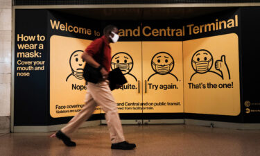 A person wears a mask while walking in Grand Central Terminal on July 27 in New York City.