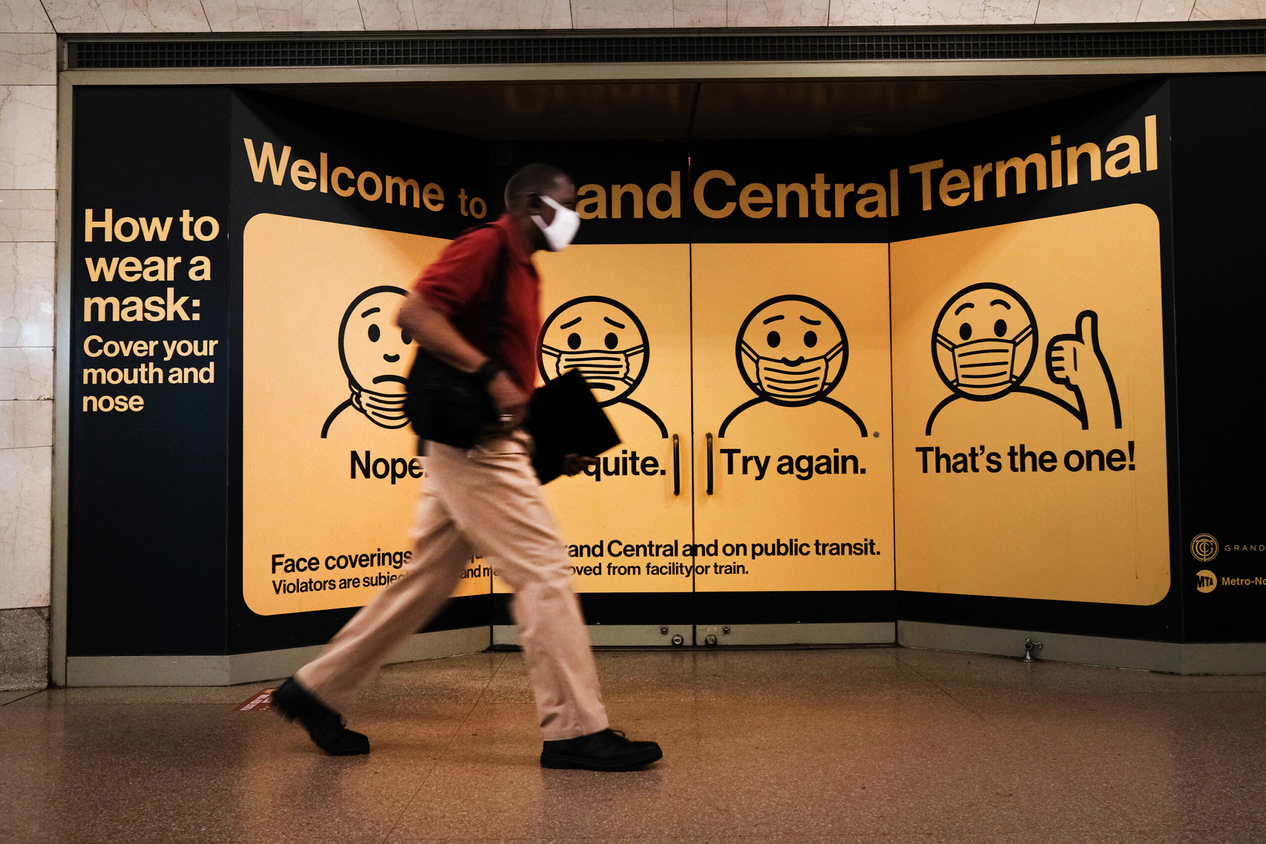 <i>Spencer Platt/Getty Images</i><br/>A person wears a mask while walking in Grand Central Terminal on July 27 in New York City.