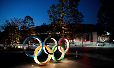 The Olympic rings are displayed outside the National Stadium