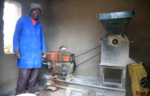 Alfred Makumbe at his grinding mill. His business has been affected by Covid.