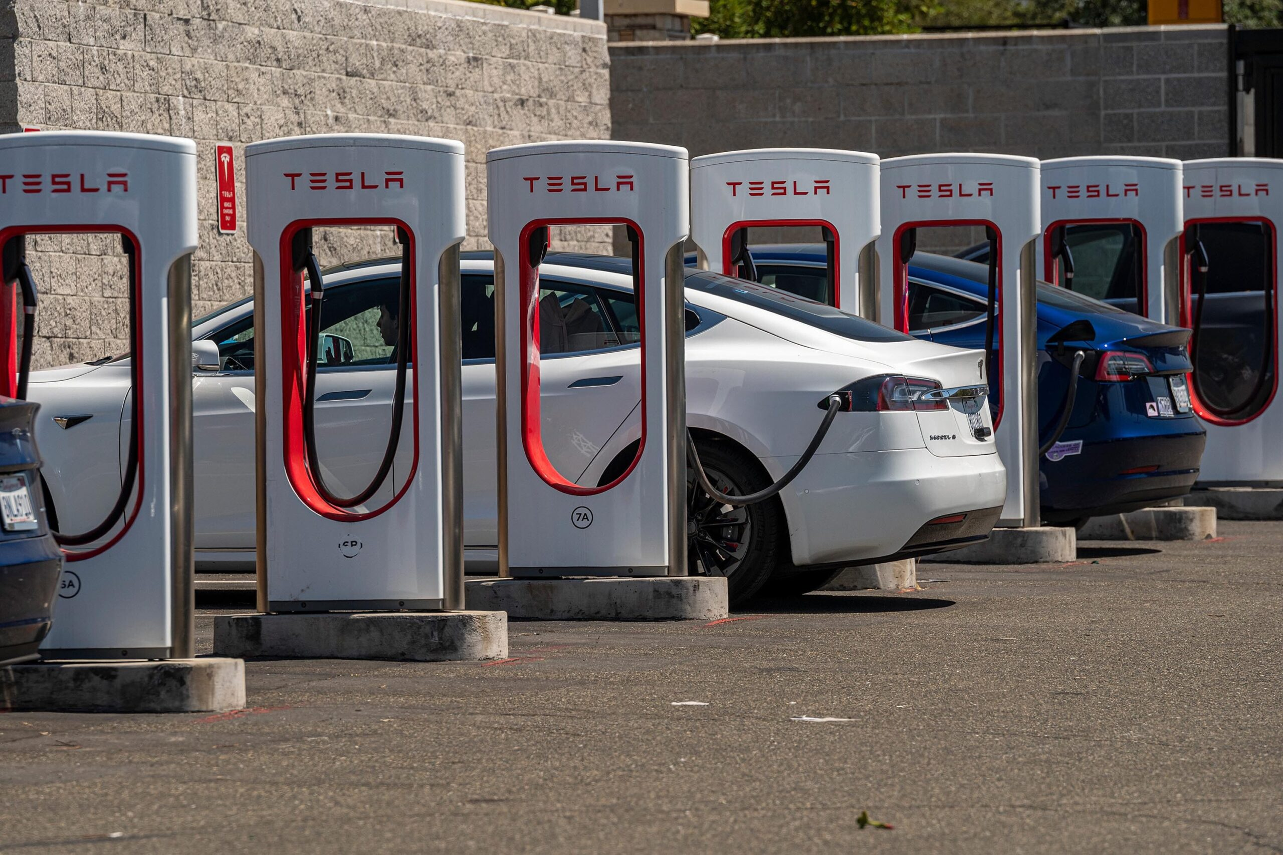 <i>David Paul Morris/Bloomberg/Getty Images</i><br/>Tesla vehicles at charging stations outside a store in Rocklin