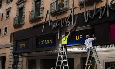 Workers replace signs at the August Wilson Theatre in New York City on June 29. More than a year into a global pandemic and amid an international social justice movement
