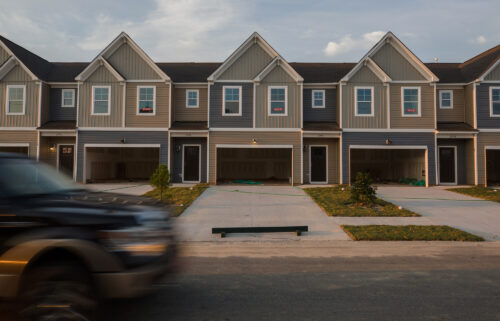 """""""Sold"""" signs in the windows of new townhomes in the Hunter's Crossing subdivision in Sumter"""