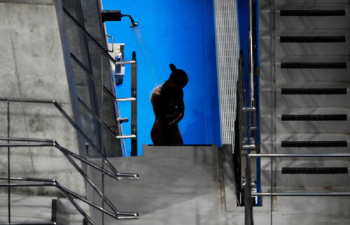 Jennifer Abel of Canada rinses off in between rounds of the women's diving 3-meter springboard preliminary event at the Tokyo Olympics on July 30