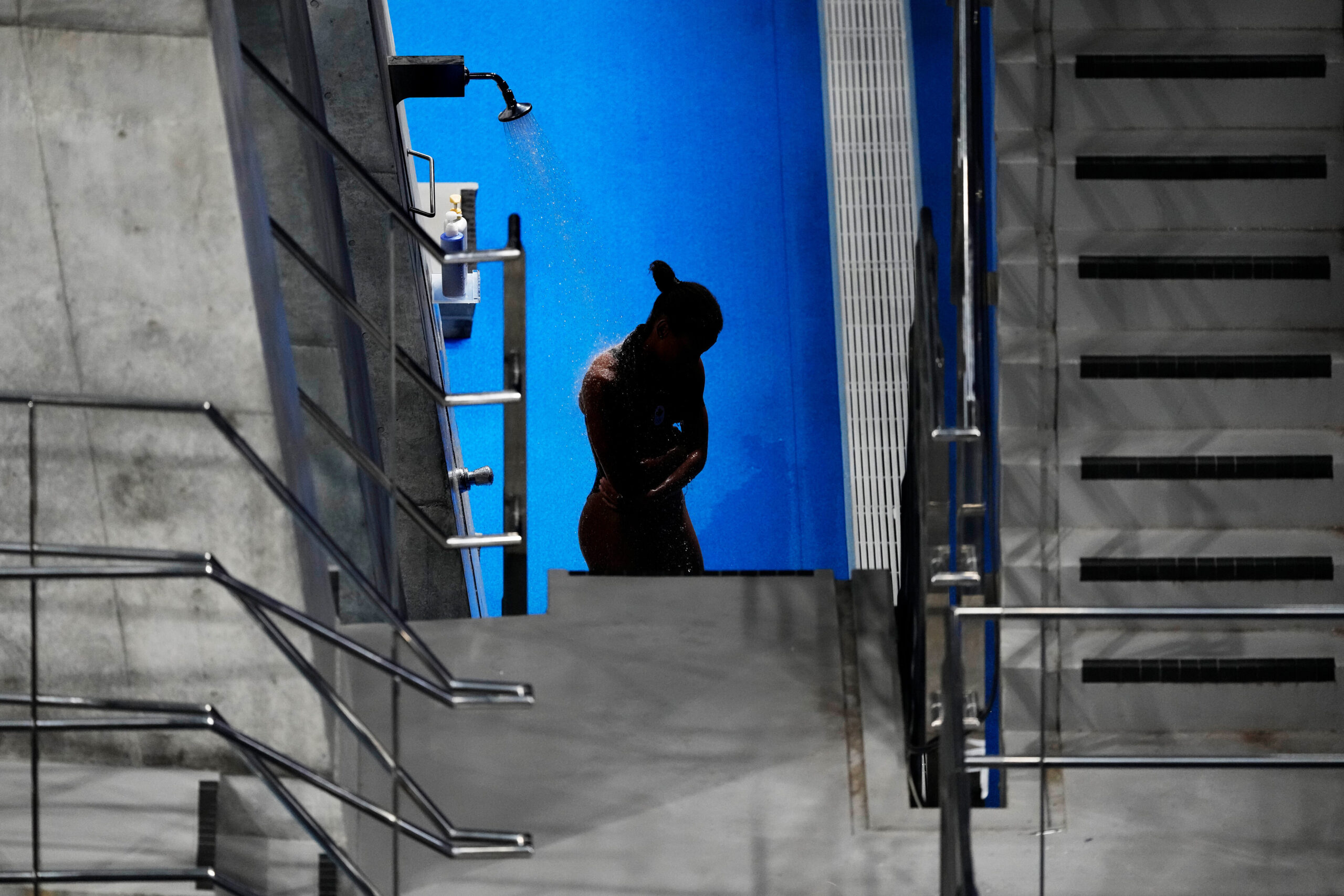 <i>David Goldman/AP</i><br/>Jennifer Abel of Canada rinses off in between rounds of the women's diving 3-meter springboard preliminary event at the Tokyo Olympics on July 30