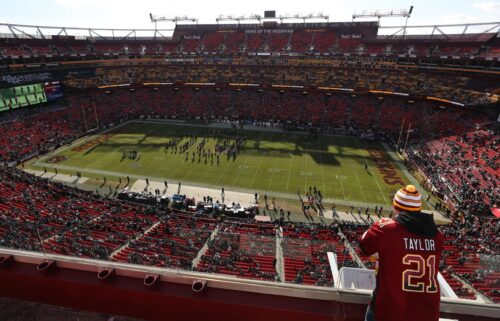 Washington fans stand in the upper deck at FedExField in Landover