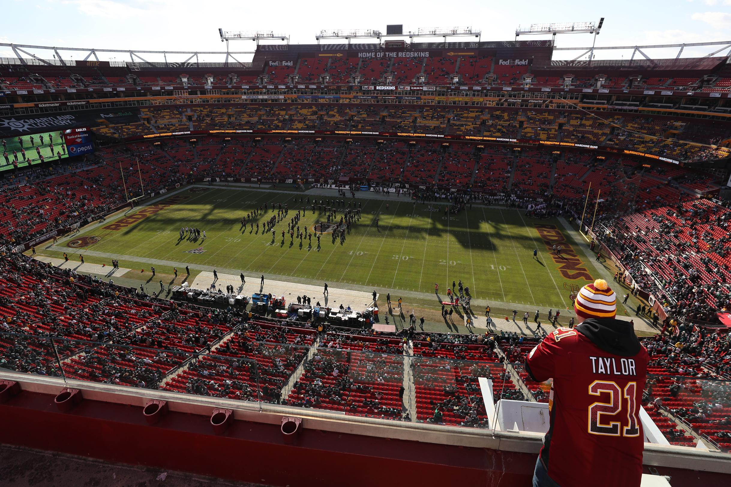 <i>Patrick Smith/Getty Images</i><br/>Washington fans stand in the upper deck at FedExField in Landover