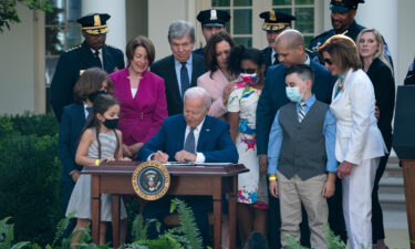 President Joe Biden signs a bill that awards Congressional gold medals to law enforcement officers that protected members of Congress at the Capitol during the January 6 riots.