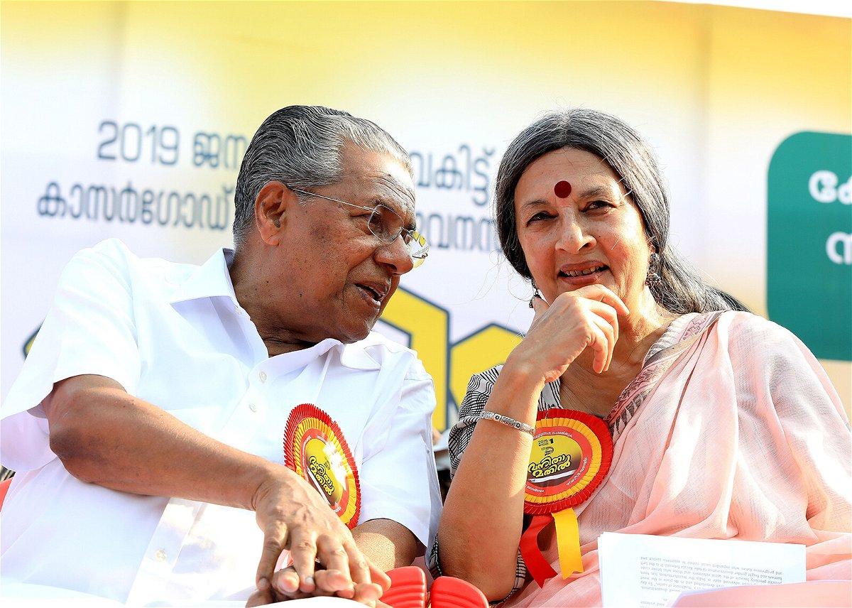 <i>Vivek R Nair/Hindustan Times/Getty Images</i><br/>Chief Minister Pinarayi Vijayan with an activist during the