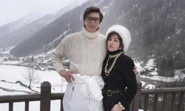 "Adam Driver stars as Maurizio Gucci and Lady Gaga as Patrizia Reggiana in ""House of Gucci."""
