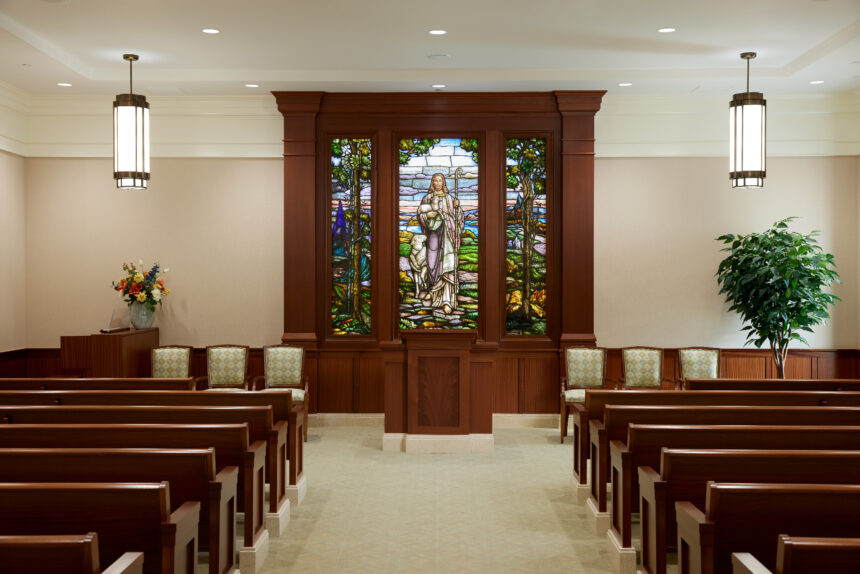 The chapel in the Pocatello Idaho Temple. The image shows pews in the chapel and stained glass depicting the Savior_2021 by Intellectual Reserve, Inc. All rights reserved.