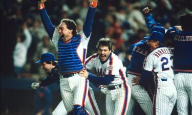 Gary Carter and Wally Backman celebrate after winning the 1986 World Series between the New York Mets and the Boston Red Sox.
