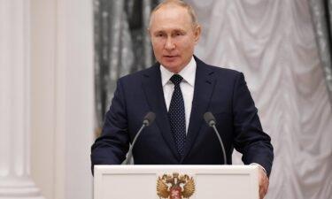 'Several dozen' in Russian President Vladimir Putin's inner circle have tested positive for coronavirus. Putin is seen here at the Kremlin on Monday.