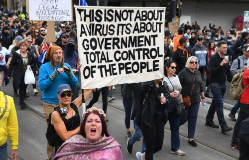 Protesters march through the streets during an anti-lockdown rally in Melbourne on Sept. 18.