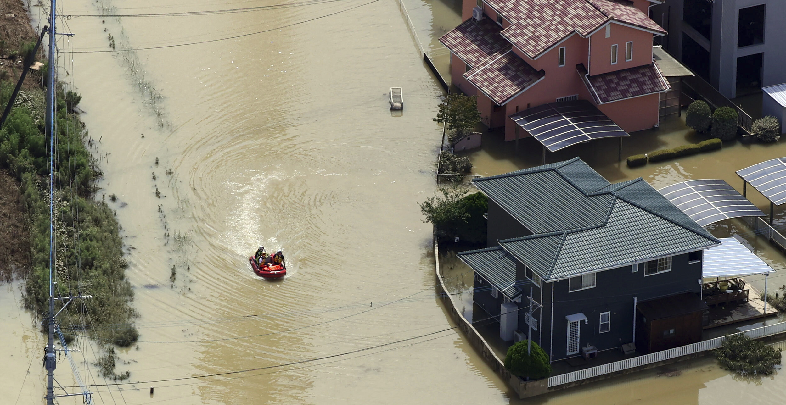 <i>Yomiuri Shimbun/AP</i><br/>Most people around the world don't think the US is doing a good job on the issue of climate change. Flooding due to heavy rain here inundated Takeo City in western Japan on August 15.