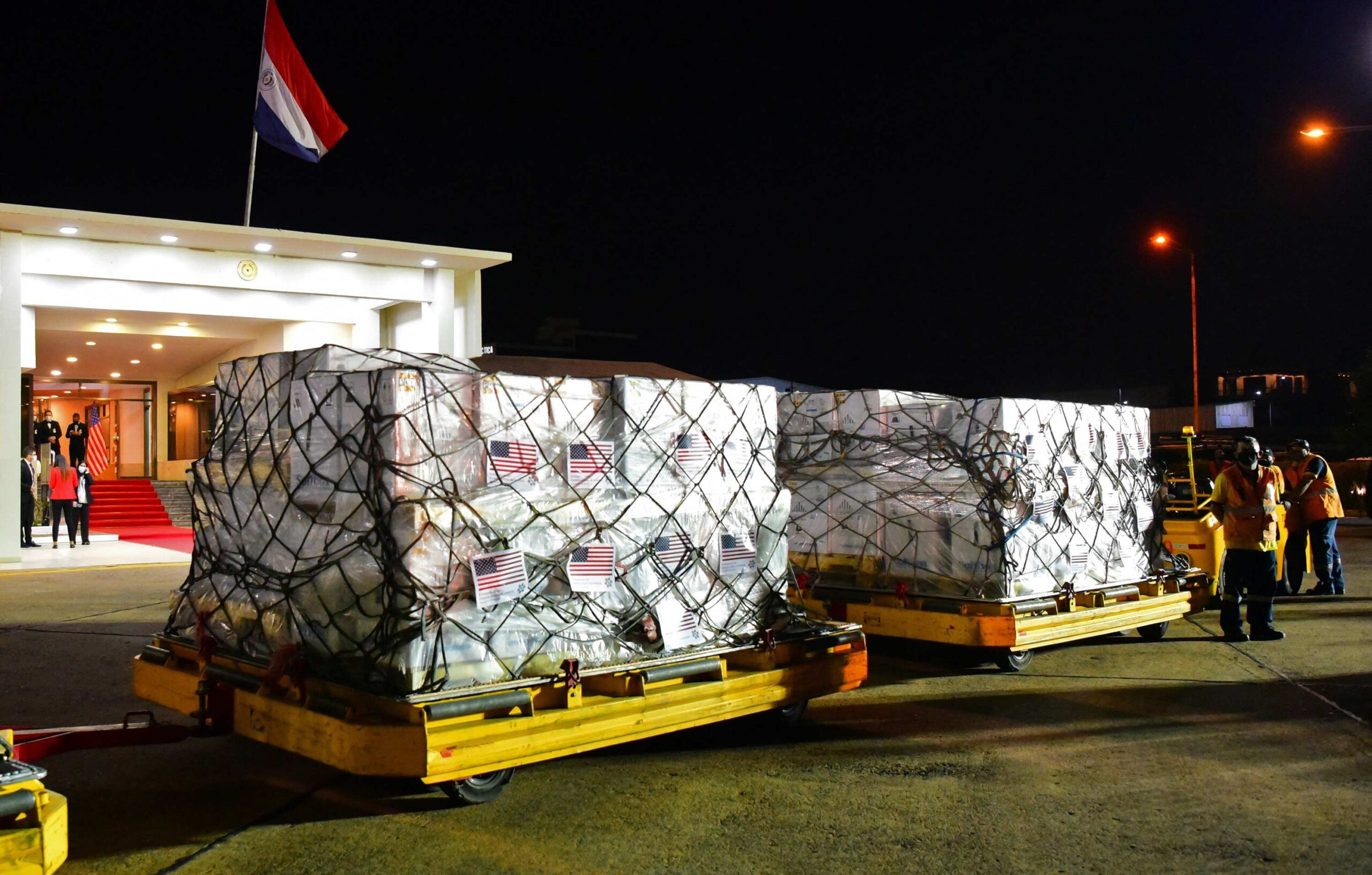 Boxes containing some of the one million doses of the Pfizer vaccine against Covid-19 donated by the United States, are seen upon arrival at the Silvio Pettirossi International Airport, in Luque, Paraguay, on July 9. The United States is set to significantly increase the amount of Covid-19 vaccines it will ship to foreign nations beginning in 2022 in an effort to end the pandemic worldwide, the White House announced Wednesday. Mandatory Credit: