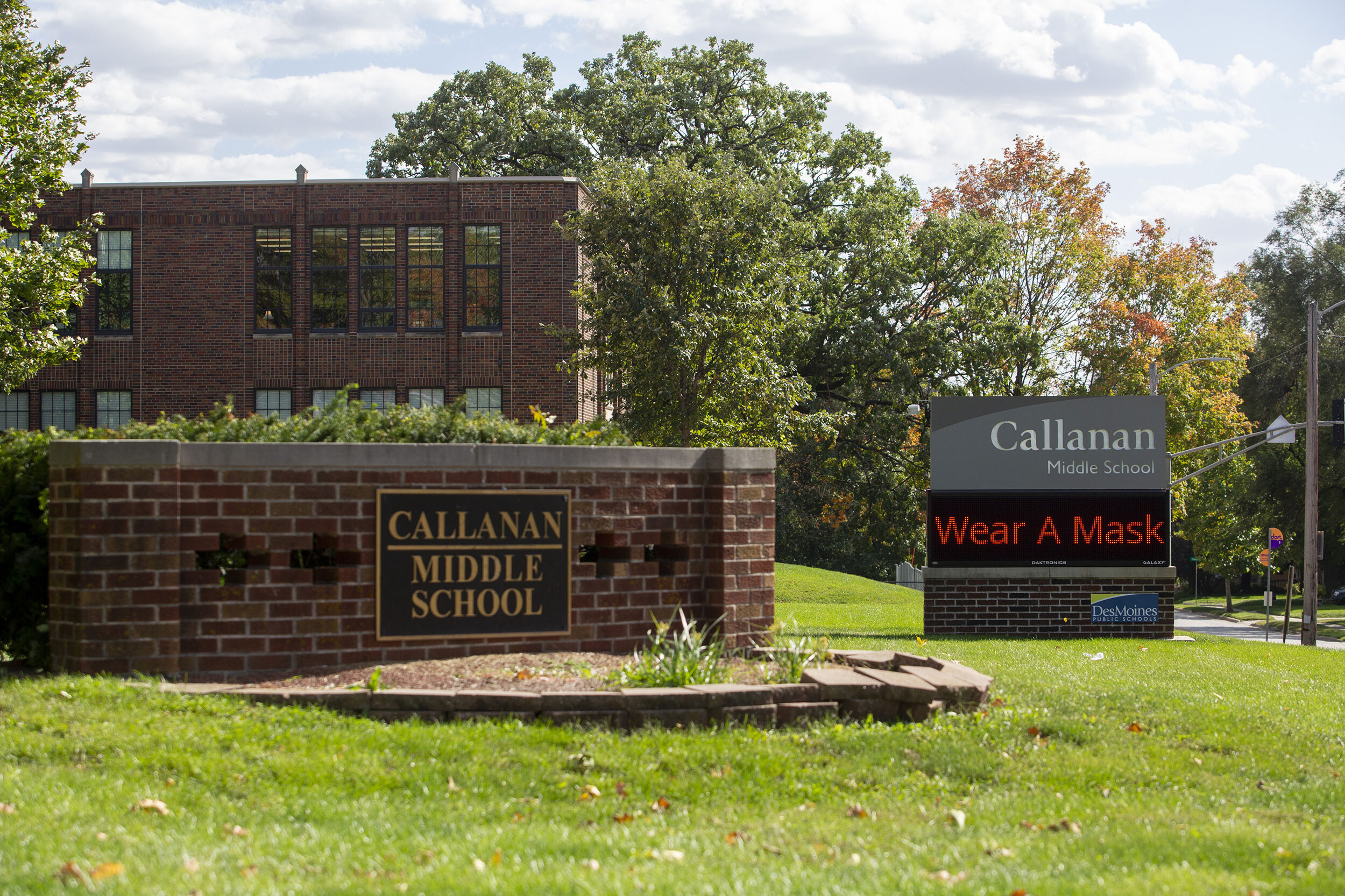 <i>Rachel Mummey/Bloomberg/Getty Images</i><br/>Des Moines Public Schools officials will reinstate the district's mask mandate Wednesday. A sign reminds people to wear a mask outside Callanan Middle School in Des Moines