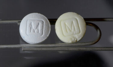 An image from the DEA shows an authentic 30mg oxycodone pill on the left