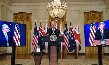 President Joe Biden speaks on national security with British Prime Minister Boris Johnson (L) and Australian Prime Minister Scott Morrison (R) at the White House in Washington