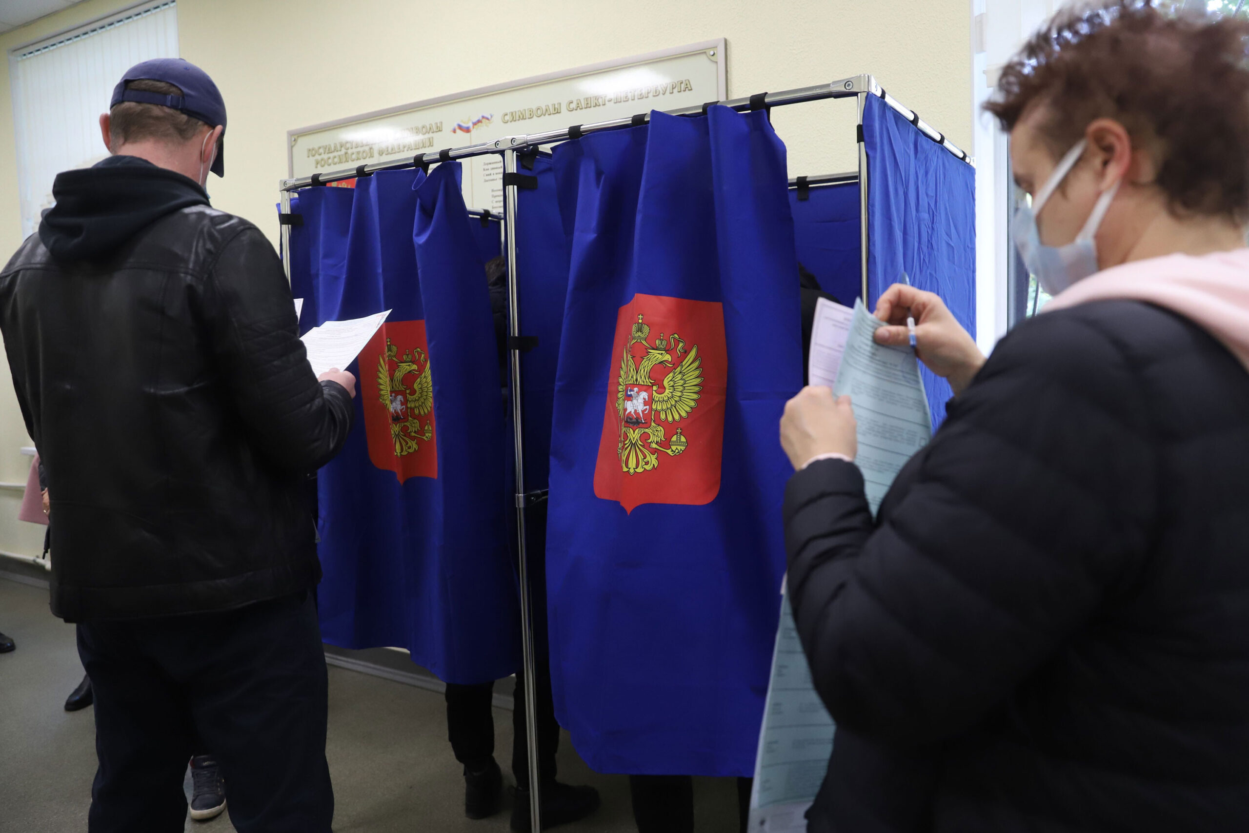 <i>Sergei Mikhailichenko/SOPA Image/Shutterstock</i><br/>People vote during the last day of the three-day parliamentary and local elections in Russia.