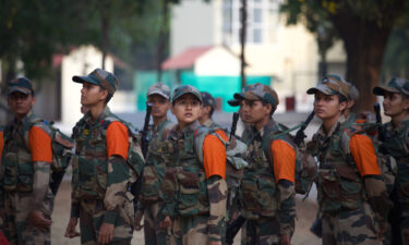 Female recruit soldiers from the Indian army wait during a media visit to the Corps of Military Police Centre and School on March 31 in Bengaluru