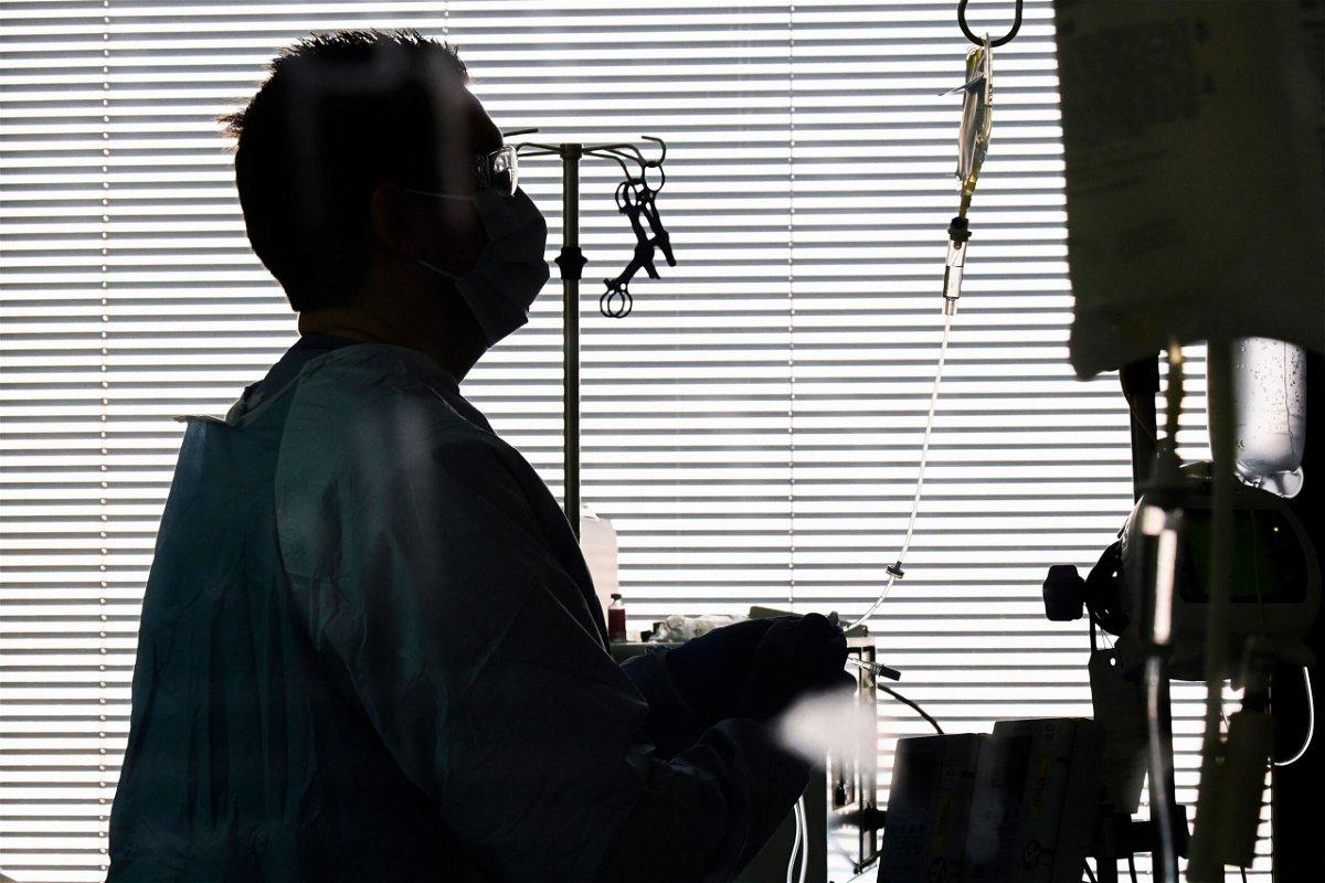 <i>Julie Bennett/AP</i><br/>East Alabama Medical Center nurse Harvard Graham checks fluids for a Covid-19 patient in the intensive care unit Thursday