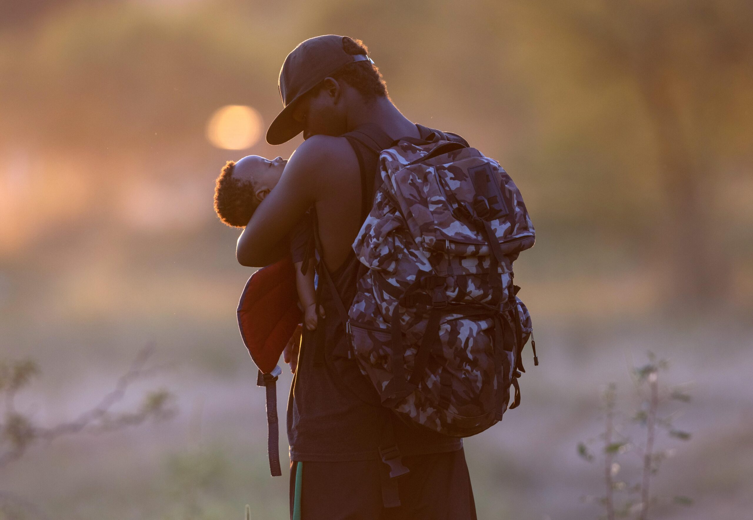 <i>John Moore/Getty Images</i><br/>An exhausted Haitian father cradles his son on the Mexican side of the Rio Grande from Del Rio