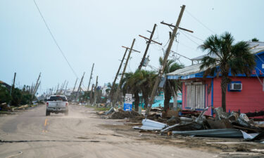 A motorist drives down a road in the wake of Hurricane Ida on September 4