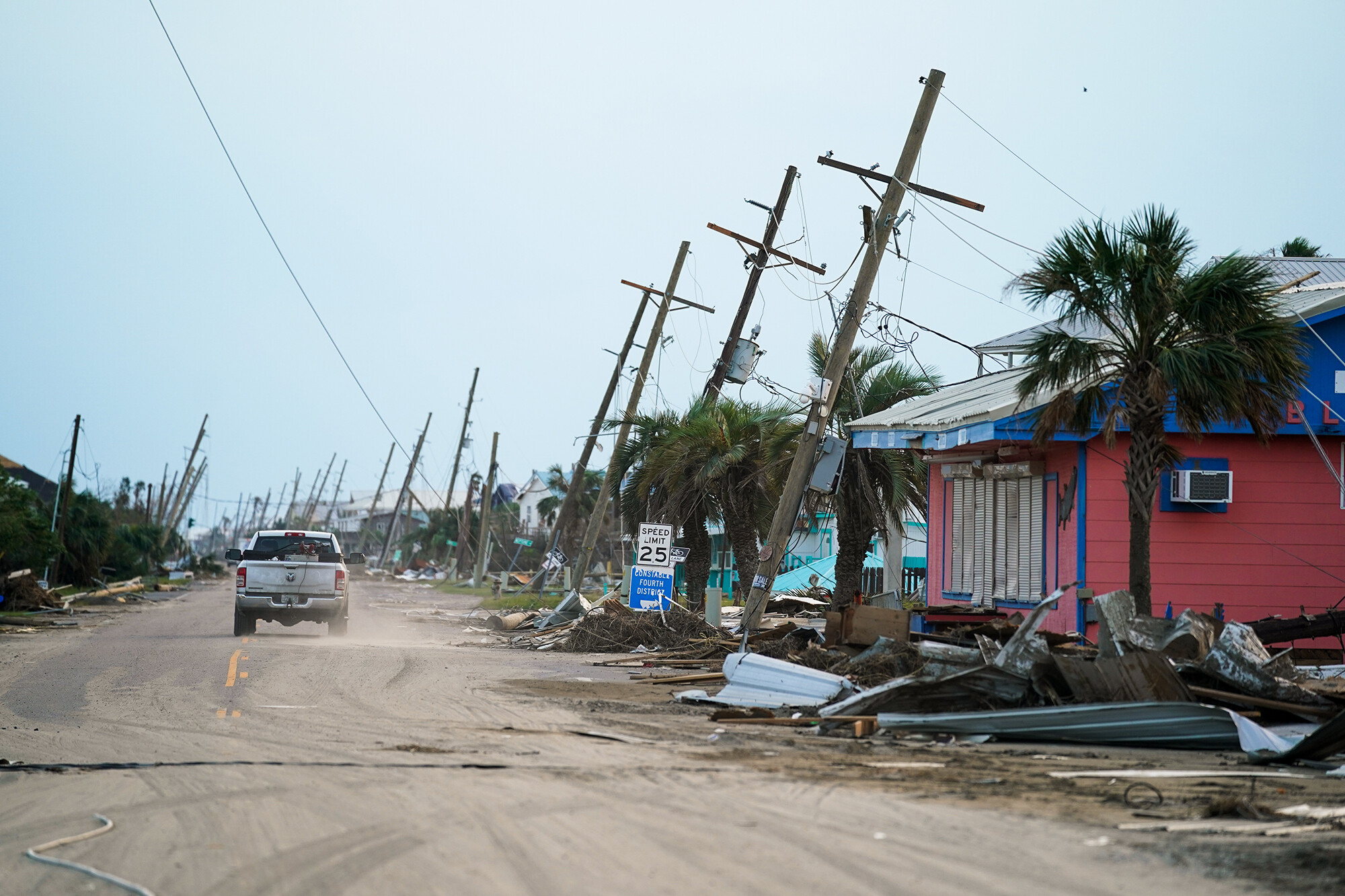 <i>Sean Rayford/Getty Images</i><br/>A motorist drives down a road in the wake of Hurricane Ida on September 4