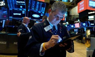 Trader John Panin works on the floor of the New York Stock Exchange