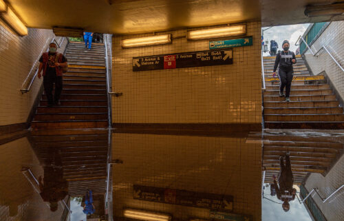 Commuters walk into a flooded 3rd Avenue / 149th st subway station and disrupted service due to extremely heavy rainfall from the remnants of Hurricane Ida on September 2