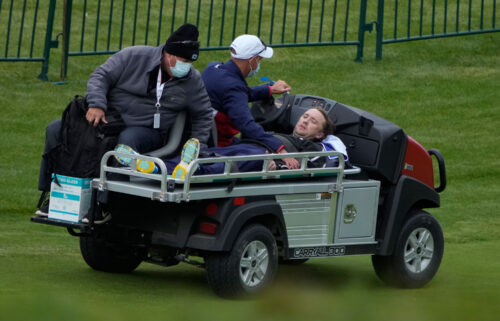 Felton is carted off the course.